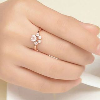 square wedding ring on hand